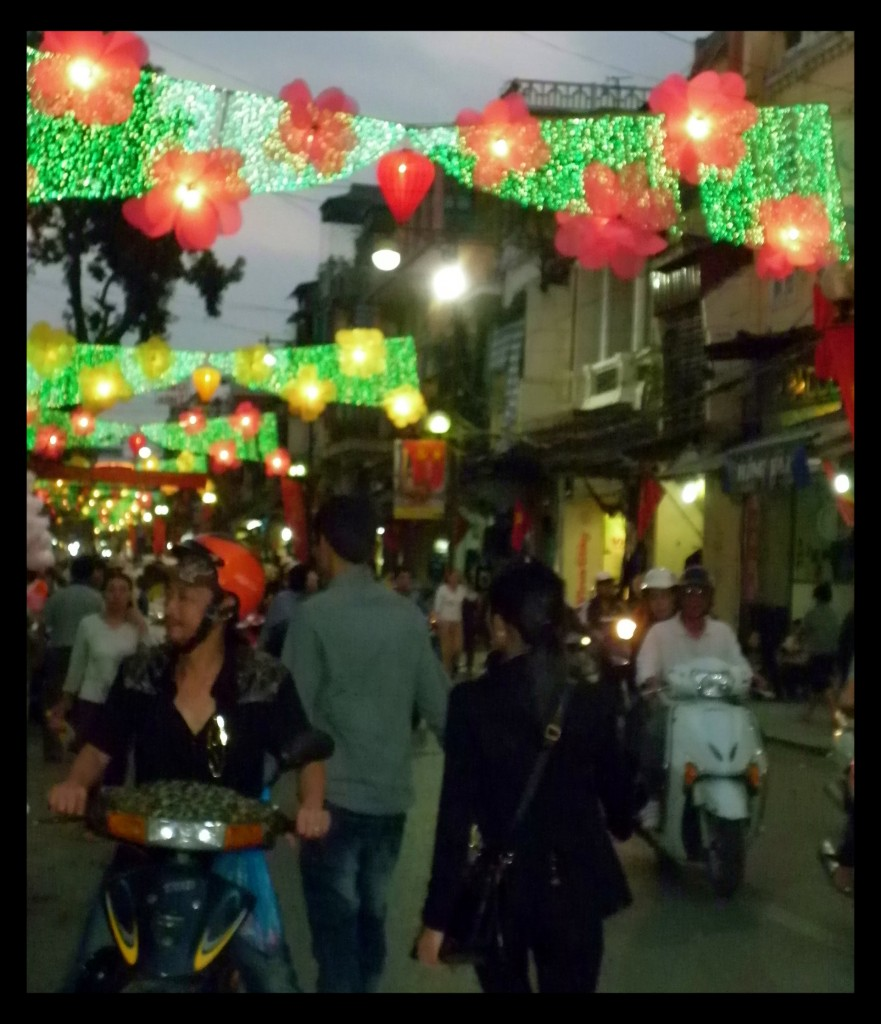The city is all dressed up for Tet.  One of the main roads in Hanoi's Old Quarter.