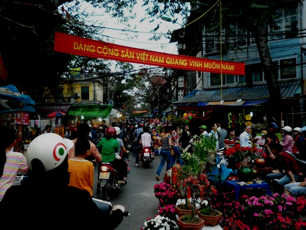 A busy Hanoi marketplace dedicated to providing all things related to Tet, or the Vietnamese New Year.  The banner above, roughly translated: The Communist Party of Vietnam Shining Forever!