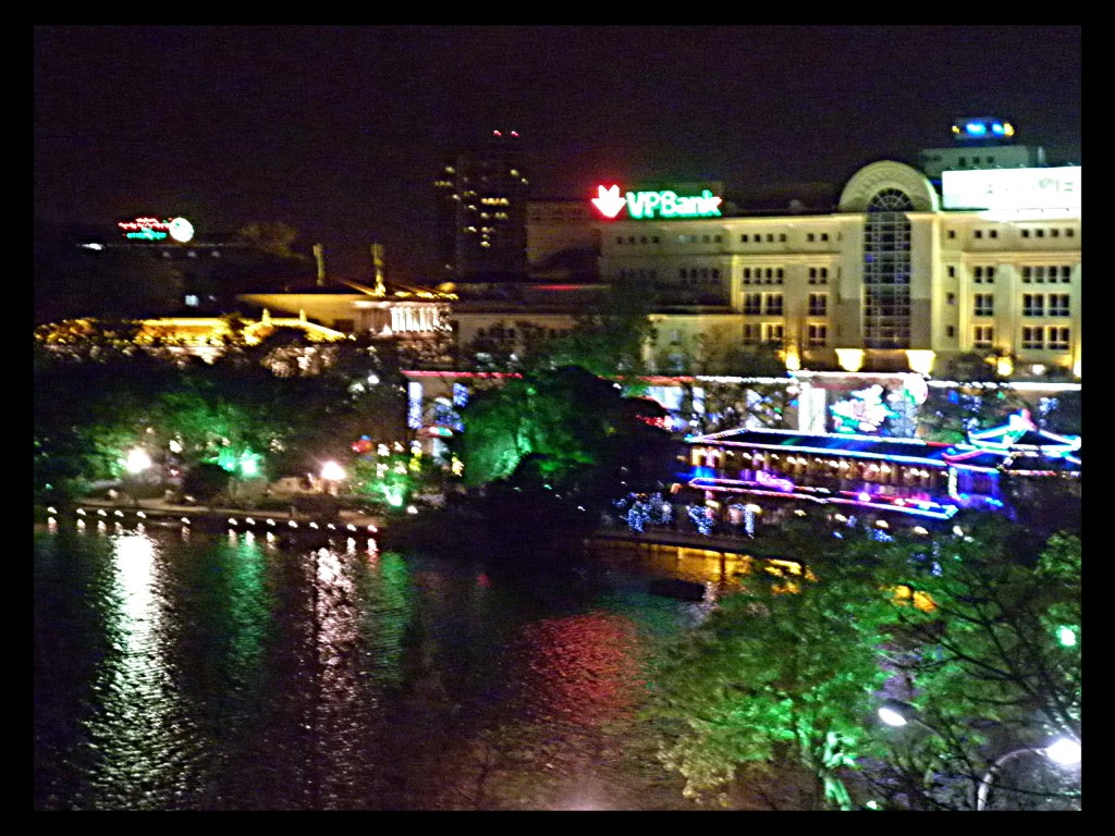 The view of Northern banks of Hoan Kiem Lake.  Not so dissimilar to the flashing neon lights of my hometown of Reno.
